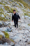 Woman hiker on a trail Stock Image