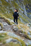 Woman hiker on a trail Royalty Free Stock Image