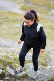 Woman hiker on a trail Stock Photography