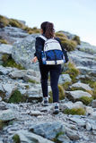 Woman hiker on a trail Stock Images