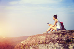 Woman hiker use digital tablet at mountain Stock Photo
