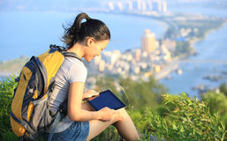 Woman hiker use digital tablet mountain peak Stock Photography