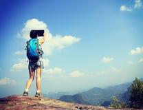 Woman hiker use digital tablet at mountain Stock Photos