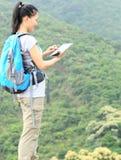 Woman hiker use digital tablet Royalty Free Stock Image