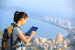Woman hiker use digital tablet Royalty Free Stock Photo