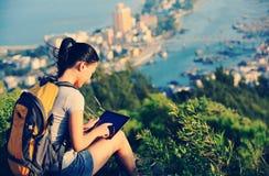 Woman hiker use digital tablet Stock Photo