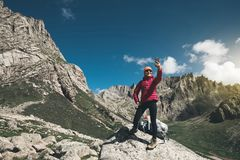 Woman hiker use smartphone in mountain top rock. Successful woman hiker use smartphone in mountain top rock Stock Photography