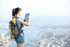 Woman hiker use tablet mountain peak Stock Image