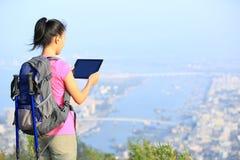 Woman hiker use tablet mountain peak Stock Photos