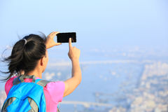 Woman hiker use tablet mountain peak Royalty Free Stock Image