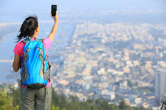 Woman hiker use tablet mountain peak Royalty Free Stock Images