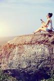 Woman hiker use tablet mountain peak Royalty Free Stock Photos