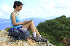 Woman hiker use tablet pc outdoor Royalty Free Stock Photos