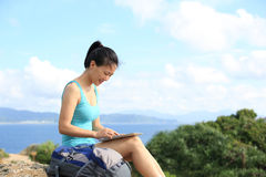Woman hiker use tablet pc outdoor Royalty Free Stock Photography