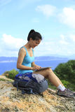 Woman hiker use tablet pc outdoor Royalty Free Stock Photo