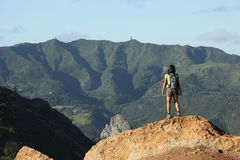 Woman hiker viewing central peaks on St Helena Stock Image