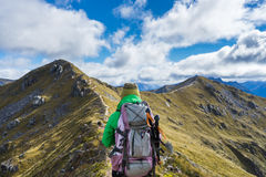 Woman hiker walking on an alpine section of the Kepler Track Royalty Free Stock Photos
