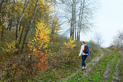 Woman hiker walking on the autumn nature Stock Photo