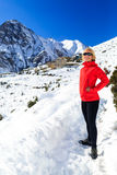 Woman hiker walking in Himalaya Mountains, Nepal Royalty Free Stock Photo