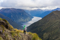 Woman hiker walking on Kepler Track Royalty Free Stock Photos