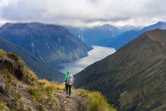 Woman hiker walking on Kepler Track Royalty Free Stock Photos