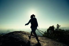 Woman hiker walking on mountain peak. Silhouette of young woman hiker walking on mountain peak Royalty Free Stock Photo