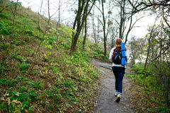 Woman hiker walking the mountain trail in weekend Royalty Free Stock Photography