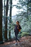 Woman hiker walking on the trail in the woods. royalty free stock photos