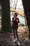 Woman hiker walking on the trail in the woods. stock image