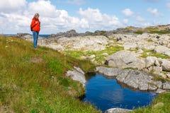 Woman hiker on wild nature Stock Photos