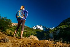 Woman hiker. Enjoys valeey views with ice caped mountain on the horizon. Chile royalty free stock photography