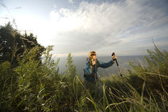 Woman hiker. XL size. Woman hiker uphill through grass. XL size Royalty Free Stock Photo