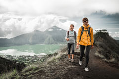 Woman hikers. Two young smiling women hikers walk in mountains Stock Photo