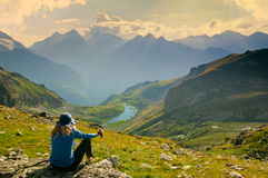Woman hiking. In the mountain Royalty Free Stock Images