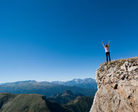 Woman hiking. In a mountain Stock Images