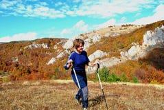 Woman hiking Stock Photo