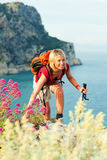 Woman hiking. Young blonde woman hiking and smiling. Copy space