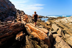 Woman hiking along the Rocky coastline Royalty Free Stock Photo