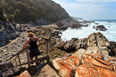 Woman hiking along the Rocky coastline Royalty Free Stock Photography