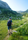 Woman hiking in alps. Young woman hiking in summer on sunny day, julijan alps, slovenia Stock Images