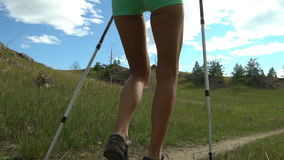 Woman hiking around mountains at summer time. stock video footage