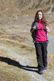 Woman hiking in autumn on Swiss Alps. Caucasian smiling woman enjoying a hike in autumn on Swiss alps Royalty Free Stock Photography