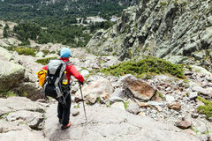 Woman hiking with backpack in Corsica mountains Royalty Free Stock Image