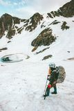 Woman hiking with backpack and ice axe Travel Lifestyle survival concept Royalty Free Stock Photos