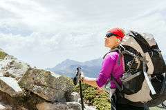 Woman hiking with backpack in mountains, France Stock Images