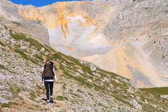 Woman Hiking with Backpack in Mountains on top Stock Photography