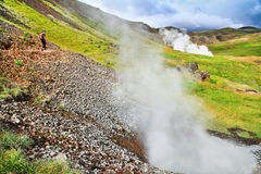 Woman hiking in beautiful geothermal landscape in Iceland Stock Photos