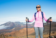 Woman hiking on beautiful mountain trail. Stock Photo