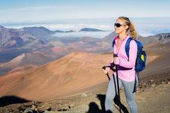 Woman hiking on beautiful mountain trail. Stock Photo