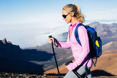 Woman hiking on beautiful mountain trail. Trekking and backpacking in the mountains. Healthy lifestyle outdoor adventure concept royalty free stock image